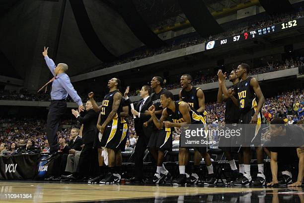 Head coach Shaka Smart of the Virginia Commonwealth Rams and the bench react during the southwest regional final of the 2011 NCAA men's basketball...