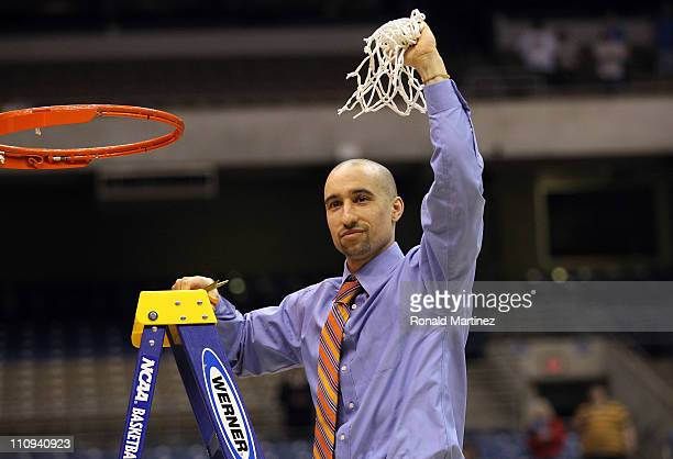 Head coach Shaka Smart of the Virginia Commonwealth Rams cuts the net after defeating the Kansas Jayhawks during the southwest regional final of the...