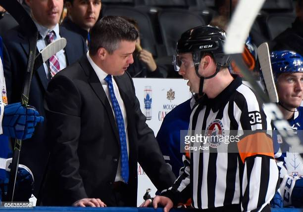 Head coach Sheldon Keefe of the Toronto Marlies gets an explanation from Referee Troy Murray against the Binghamton Senators on March 18 2017 at Air...
