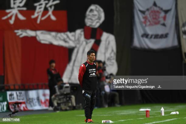 Head Coach Shuhei Yomoda of Consadole Sapporo looks on during the JLeague J1 match between Consadole Sapporo and Gamba Osaka at Sapporo Dome on May...