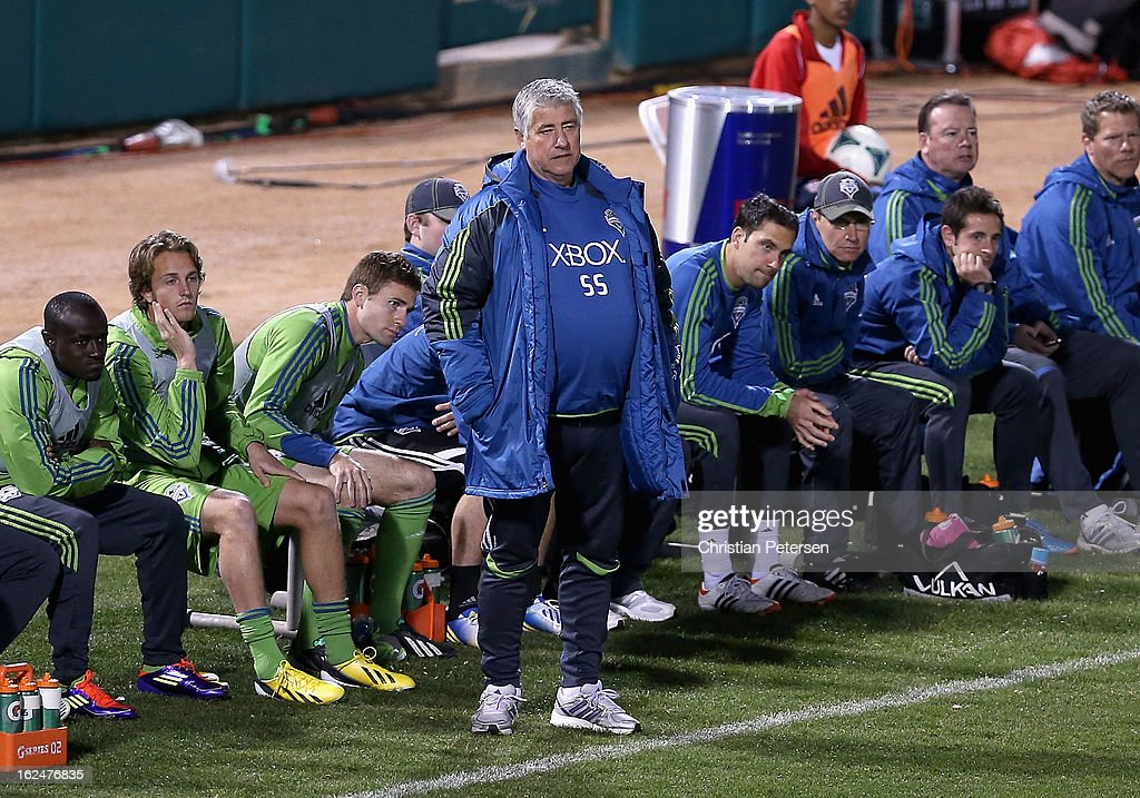 Head coach Sigi Schmid of the Seattle Sounders watches from the sidelines during FC Tucson Desert Diamond Cup Championship match against Real Salt Lake at Kino Sports Complex on February 23, 2013 in Tucson, Arizona. The Sounders defeated Real Salt Lake 1-0 to win the Championship.