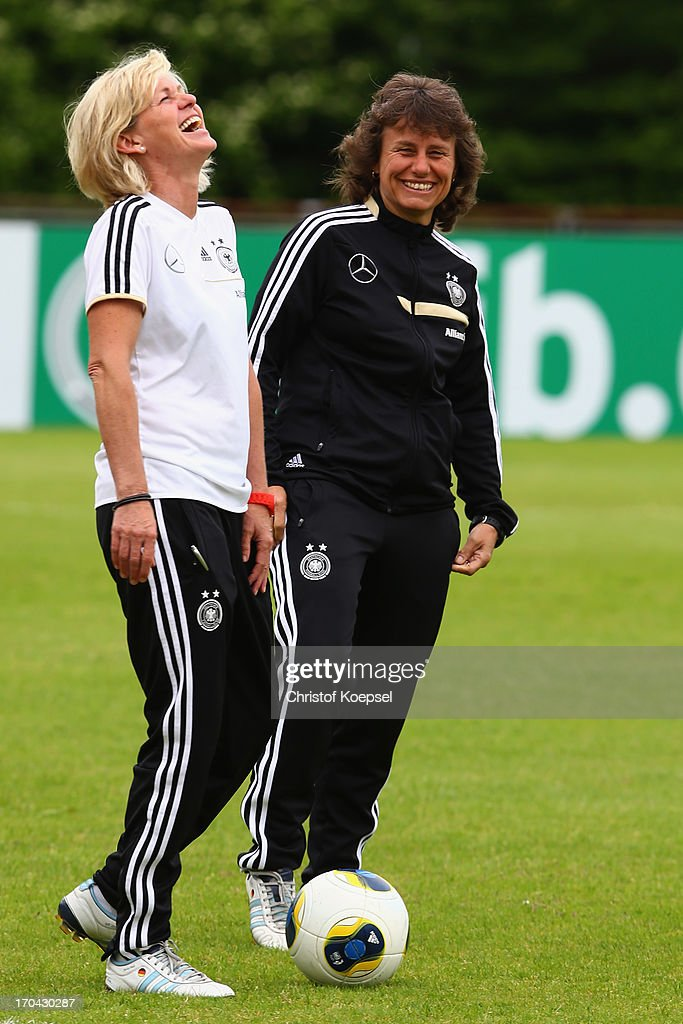 Head coach <a gi-track='captionPersonalityLinkClicked' href=/galleries/search?phrase=Silvia+Neid&family=editorial&specificpeople=641230 ng-click='$event.stopPropagation()'>Silvia Neid</a> and assistant coach <a gi-track='captionPersonalityLinkClicked' href=/galleries/search?phrase=Ulrike+Ballweg&family=editorial&specificpeople=766477 ng-click='$event.stopPropagation()'>Ulrike Ballweg</a> laugh during the training session of Women's Team Germany at training ground Ueberruhr on June 13, 2013 in Essen, Germany.