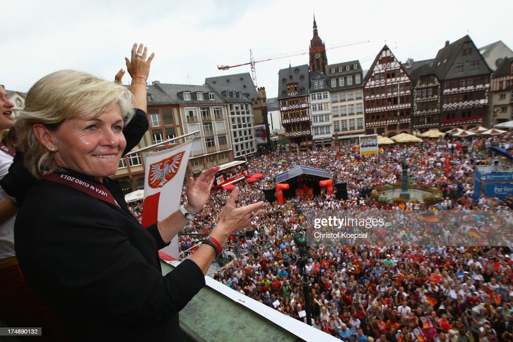 Head coach <a gi-track='captionPersonalityLinkClicked' href=/galleries/search?phrase=Silvia+Neid&family=editorial&specificpeople=641230 ng-click='$event.stopPropagation()'>Silvia Neid</a> of Germany celebrates winning the UEFA Women's EURO 2013 on the balcony of the Roemer on July 29, 2013 in Frankfurt am Main, Germany.
