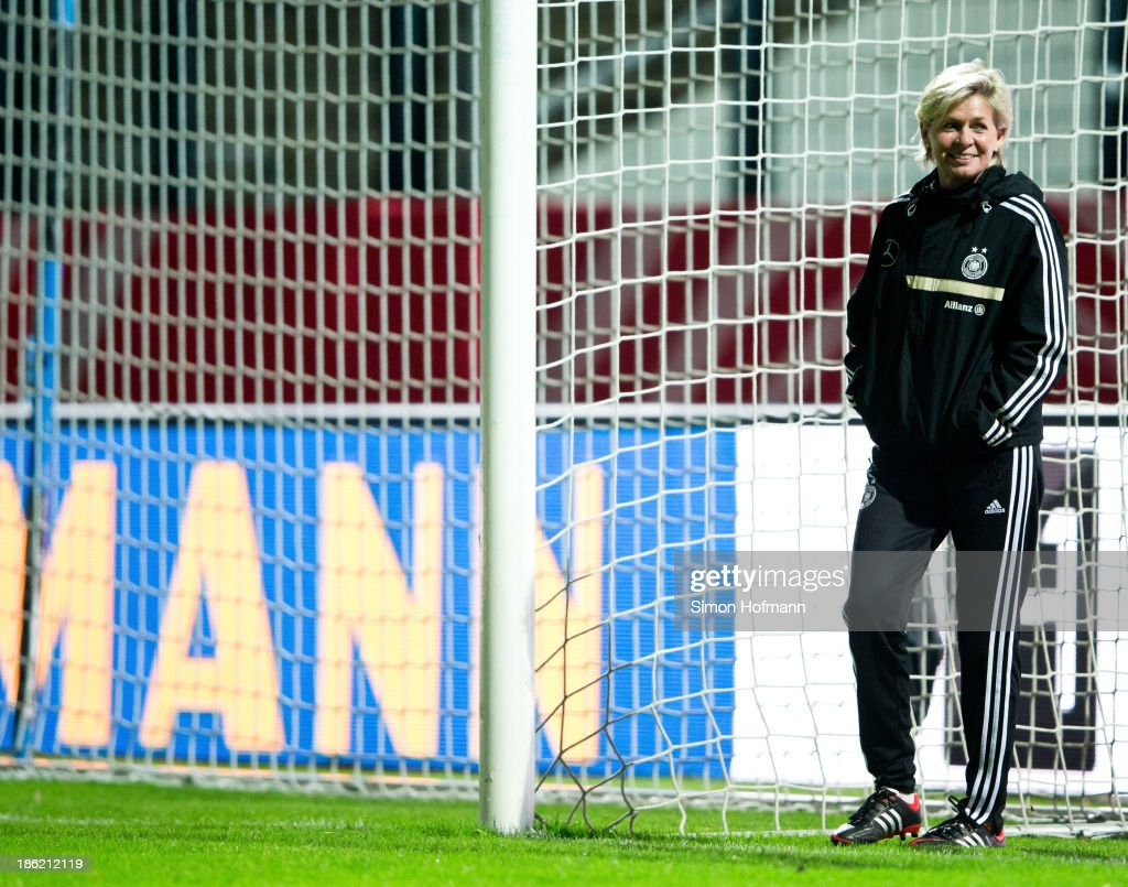 Head coach <a gi-track='captionPersonalityLinkClicked' href=/galleries/search?phrase=Silvia+Neid&family=editorial&specificpeople=641230 ng-click='$event.stopPropagation()'>Silvia Neid</a> of Germany smiles during a Germany training session at Volksbank Stadion on October 29, 2013 in Frankfurt am Main, Germany.