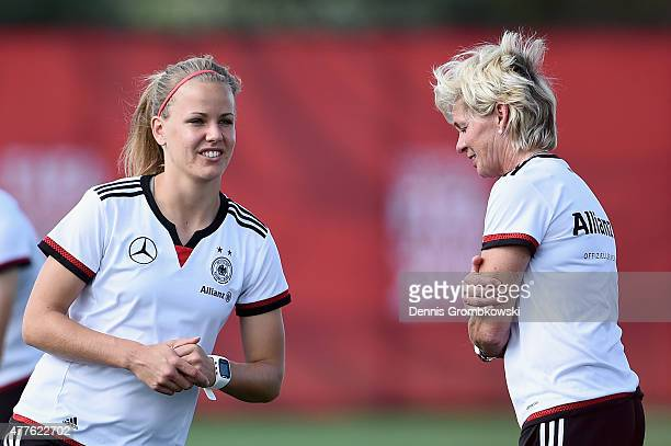 Head coach Silvia Neid of Germany talks to Lena Petermann during a training session at Wesley Clover Park on June 18 2015 in Ottawa Canada