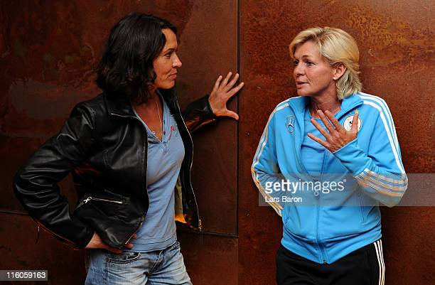 Head coach Silvia Neid speaks with actress Ulrike Folkert during the German Women National Team 'Tatort' preview at cinema Orfeos Erben on June 14...