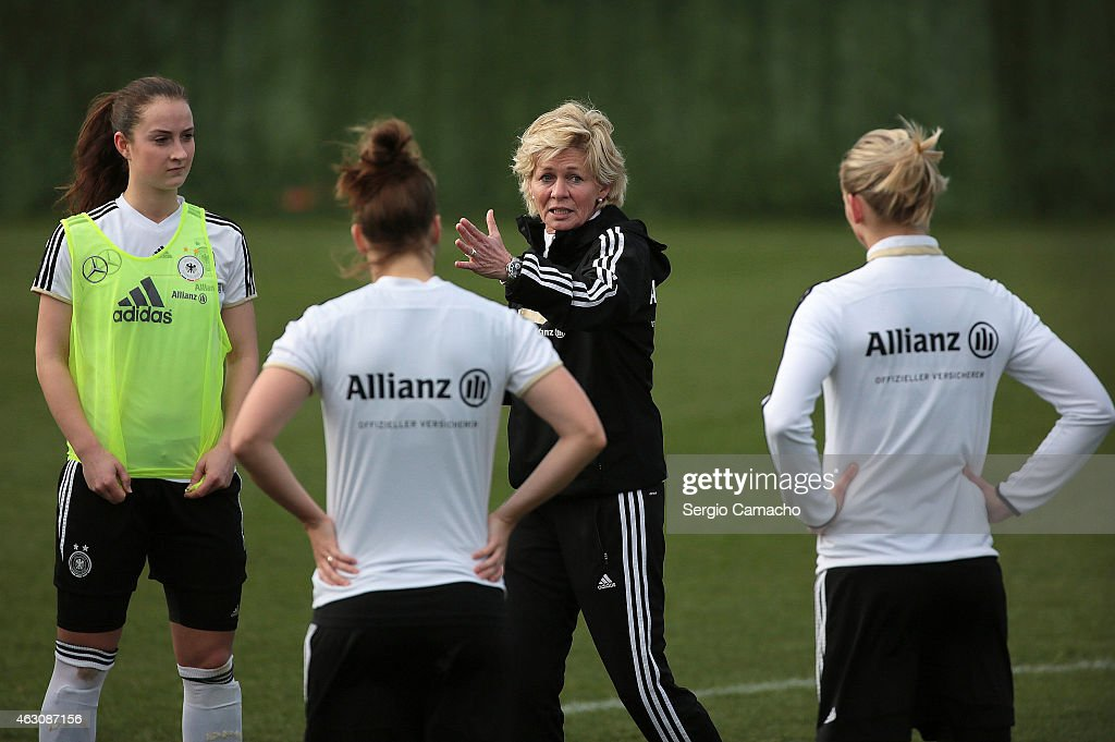 Head coach Silvia Neid talks with her players during a Germany Women's Training Session at Marbella Football Center on February 9 2015 in Marbella...