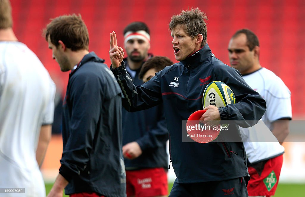 Head coach <a gi-track='captionPersonalityLinkClicked' href=/galleries/search?phrase=Simon+Easterby&family=editorial&specificpeople=178187 ng-click='$event.stopPropagation()'>Simon Easterby</a> of Scarlets gestures during the warm up before the LV= Cup match between Sale Sharks and Scarlets at Salford City Stadium on January 26, 2013 in Salford, England.
