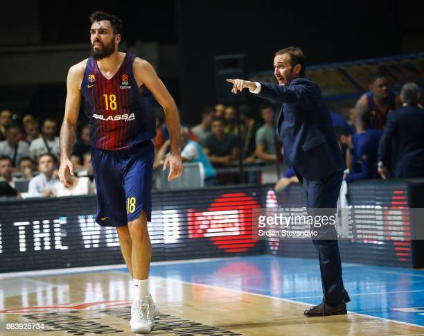Head coach Sito Alonso gives instruction to the Pierre Oriola of Barcelona during the 2017/2018 Turkish Airlines EuroLeague Regular Season game...