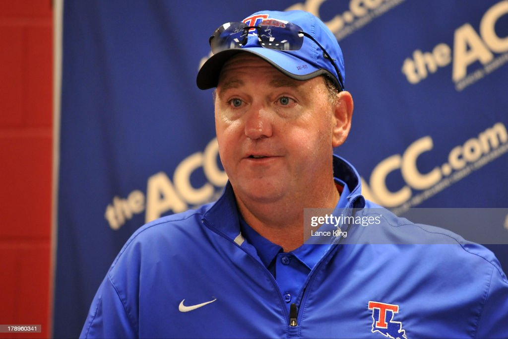 Head coach <a gi-track='captionPersonalityLinkClicked' href=/galleries/search?phrase=Skip+Holtz&family=editorial&specificpeople=4395617 ng-click='$event.stopPropagation()'>Skip Holtz</a> of the Louisiana Tech Bulldogs addresses the media following a game against the North Carolina State Wolfpack at Carter-Finley Stadium on August 31, 2013 in Raleigh, North Carolina.