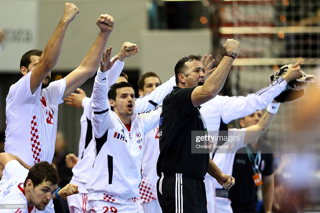 Head coach Slavko Goluza of Croatia and his team celebrate during the quarterfinal match between France and Croatia at Pabellon Principe Felipe Arena on January 23, 2013 in Barcelona, Spain.