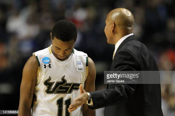 Head coach Stan Heath of the South Florida Bulls talks with Anthony Collins against the Ohio Bobcats during the third round of the 2012 NCAA Men's...