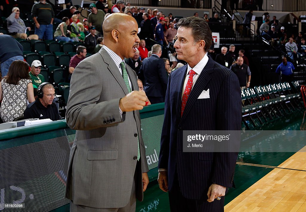 Head coach Stan Heath (left) of the South Florida Bulls talks with head coach Rick Pitino of the Louisville Cardinals just before the start of the game at the Sun Dome on February 17, 2013 in Tampa, Florida.