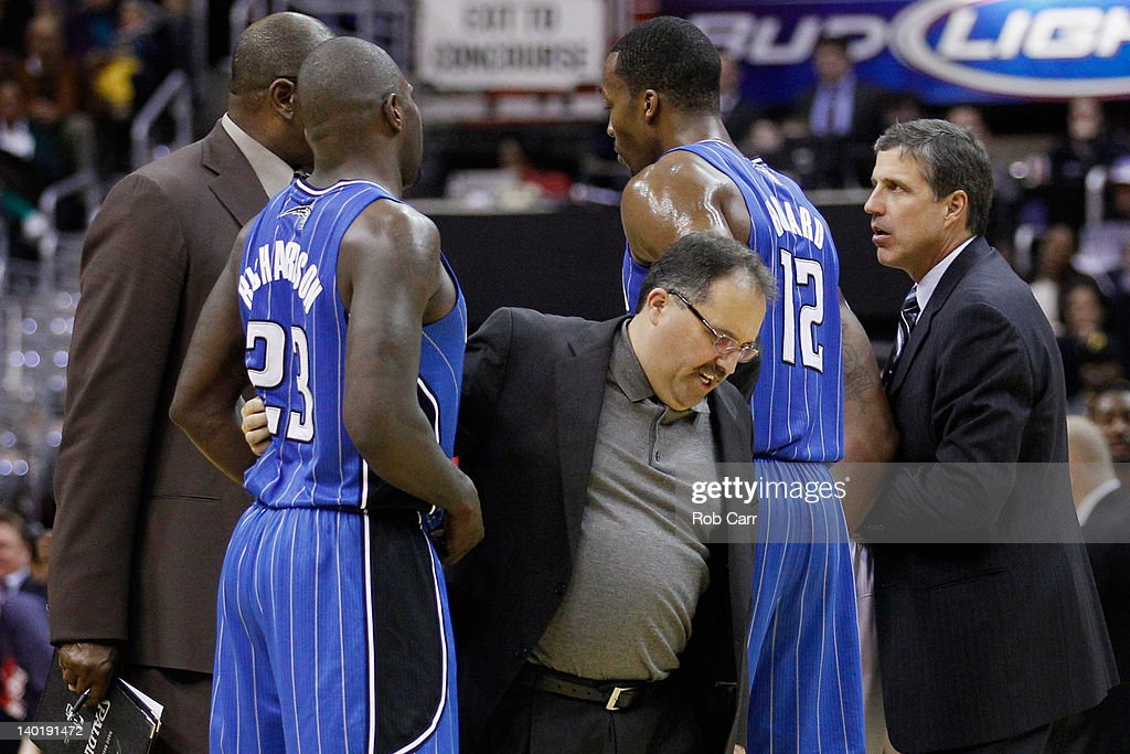 Head coach Stan Van Gundy (C) of the Orlando Magic holds back Jason Richardson #23 as head coach <a gi-track='captionPersonalityLinkClicked' href=/galleries/search?phrase=Randy+Wittman&family=editorial&specificpeople=679109 ng-click='$event.stopPropagation()'>Randy Wittman</a> of the Washington Wizards (R) comes onto the court following an altercation between the teams during the second half at the Verizon Center on February 29, 2012 in Washington, DC.