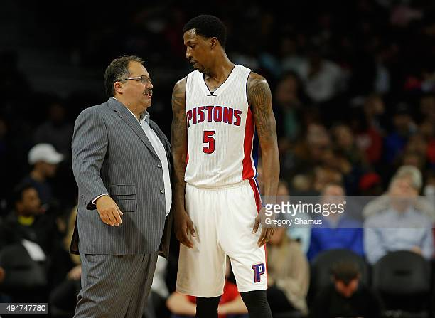 Head coach Stan Van Gundy talks to Kentavious CaldwellPope of the Detroit Pistons while playing the Utah Jazz at the Palace of Auburn Hills on...