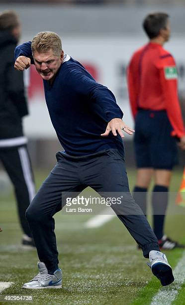 Head coach Stefan Effenberg of Paderborn celebrates after Moritz Stoppelkamp scored his teams first goal during the Second Bundesliga match between...