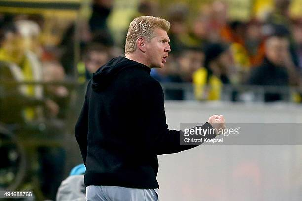 Head coach Stefan Effenberg of Paderborn celebrates the first goal of his team during the DFB Cup match between Borussia Dortmund and SC Paderborn at...