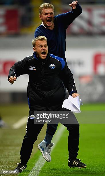Head coach Stefan Effenberg of Paderborn celebrates with assistant coach Soeren Osterland after the second goal during the Second Bundesliga match...
