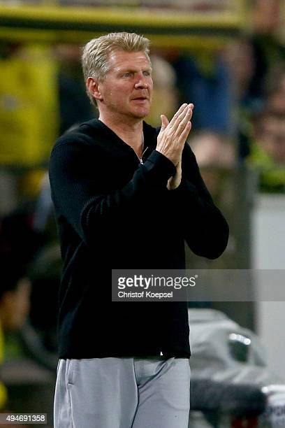 Head coach Stefan Effenberg of Paderborn prays during the DFB Cup match between Borussia Dortmund and SC Paderborn at Signal Iduna Park on October 28...