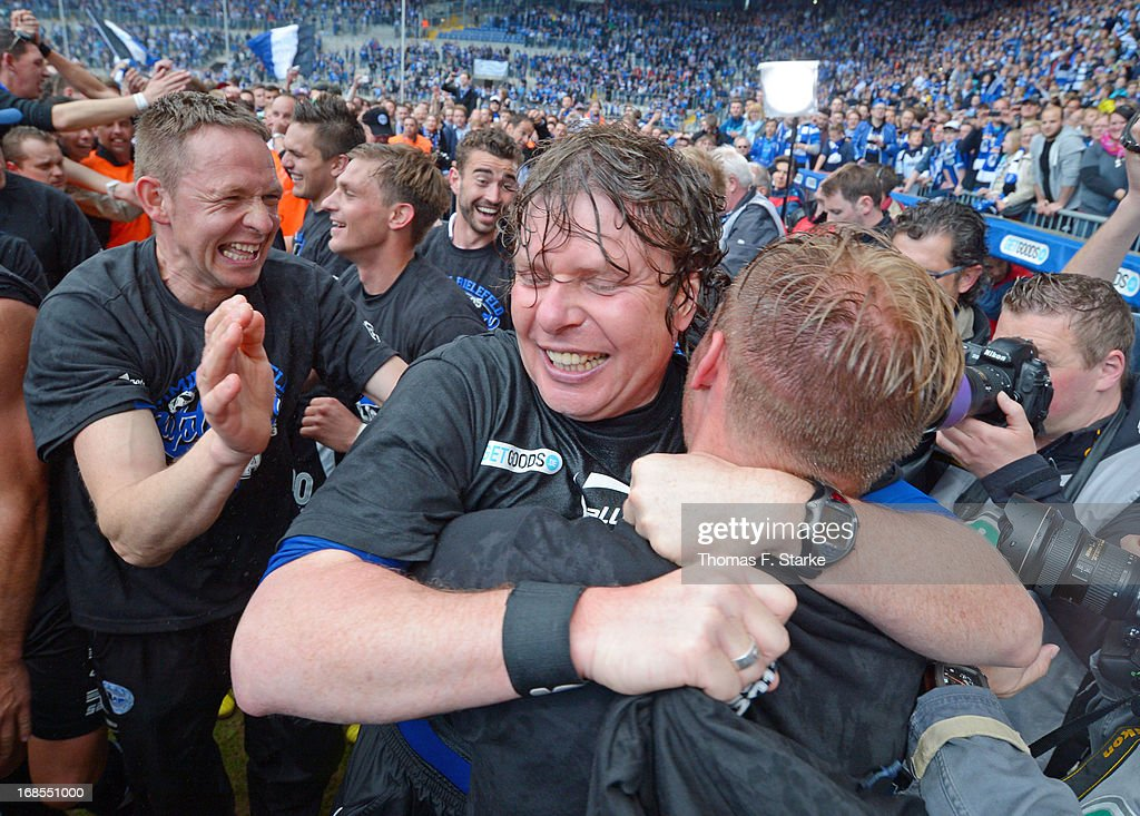 Head coach Stefan Kraemer (C) celebrates after the Third League match between Arminia Bielefeld and VfL Osnabrueck at Schueco Arena on May 11, 2013 in Bielefeld, Germany.