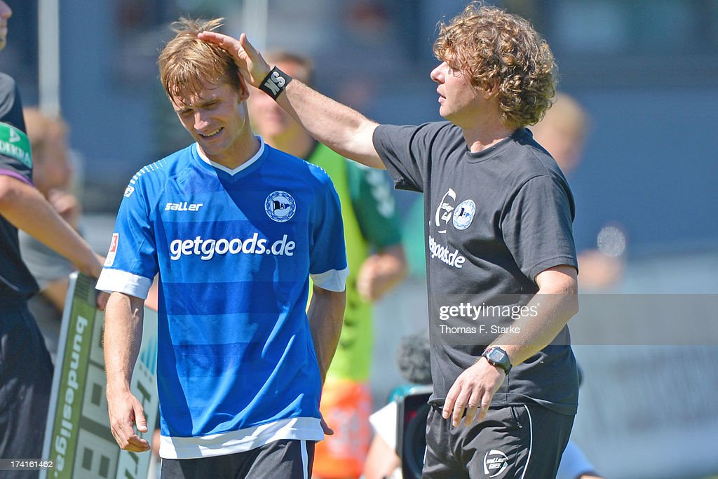 Head coach Stefan Kraemer (R) comforts Sebastian Hille of Bielefeld during the Second Bundesliga match between Greuther Fuerth and Arminia Bielefeld at the Trolli Arena on July 21, 2013 in Fuerth, Germany.