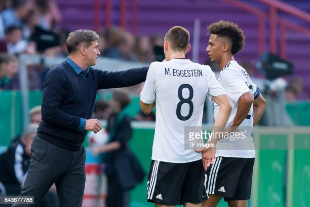 Head coach Stefan Kuntz of Germany speak with Maximilian Eggestein of Germany und Thilo Kehrer of Germany during the U21 UEFA 2018 EM Qualifying...