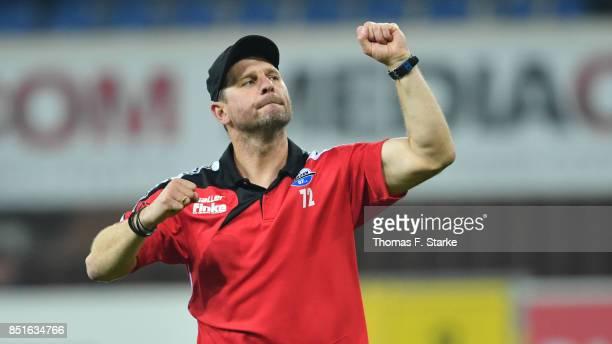 Head coach Steffen Baumgart of Paderborn celebrates after winning the 3 Liga match between SC Paderborn 07 and FC Hansa Rostock at Benteler Arena on...