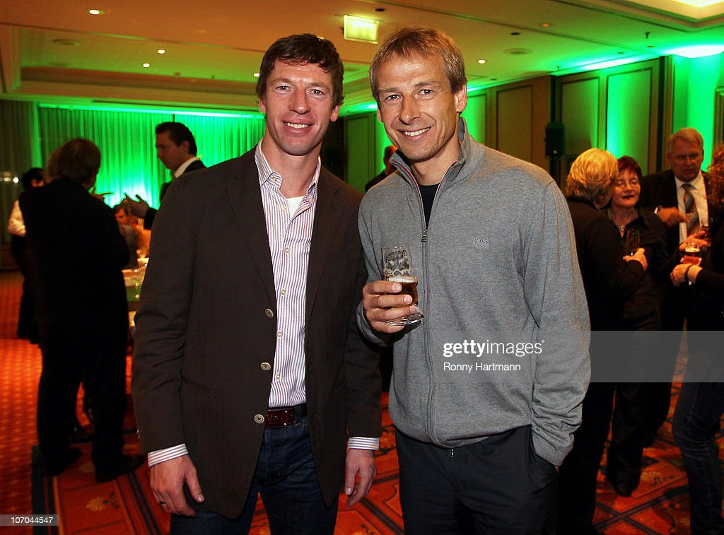 Head coach <a gi-track='captionPersonalityLinkClicked' href=/galleries/search?phrase=Steffen+Freund&family=editorial&specificpeople=653880 ng-click='$event.stopPropagation()'>Steffen Freund</a> (L) of U17 Team Germany and Juergen Klinsmann of the World Champion 1990 pose during the Players Night at the Westin Hotel on November 20, 2010 in Leipzig, Germany.
