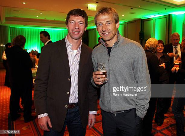 Head coach Steffen Freund of U17 Team Germany and Juergen Klinsmann of the World Champion 1990 pose during the Players Night at the Westin Hotel on...