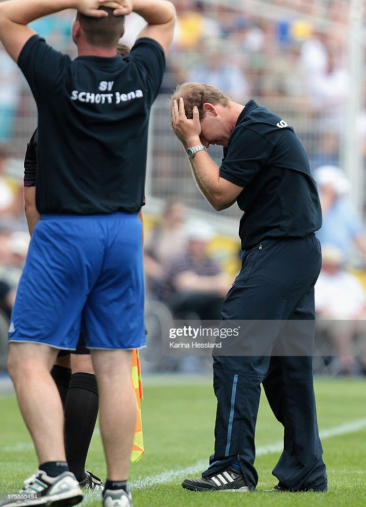 Head coach Steffen Geisendorf of Jena looks disappointed after missing a goal change during the DFB Cup between SV Schott Jena and Hamburger SV at Ernst-Abbe-Sportfeld on August 04, 2013 in Jena, Germany.