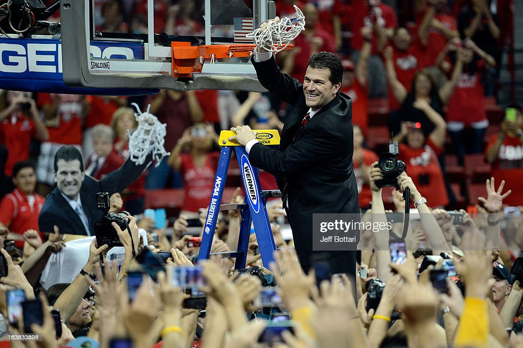 Head coach <a gi-track='captionPersonalityLinkClicked' href=/galleries/search?phrase=Steve+Alford&family=editorial&specificpeople=233486 ng-click='$event.stopPropagation()'>Steve Alford</a> of the New Mexico Lobos cuts down the net after defeating the UNLV Rebels 63-56 to win the the championship game of the Reese's Mountain West Conference Basketball tournament at the Thomas & Mack Center on March 16, 2013 in Las Vegas, Nevada.