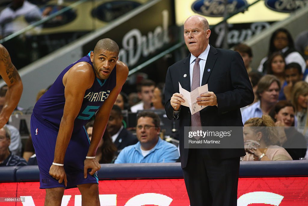 Head coach Steve Clifford and Nicolas Batum of the Charlotte Hornets during play against the Dallas Mavericks at American Airlines Center on November...