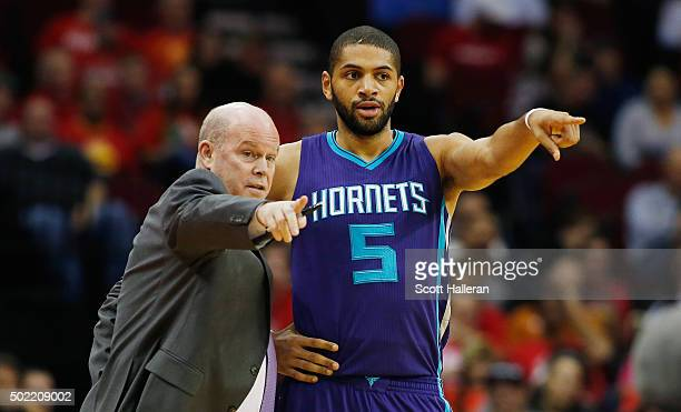 Head coach Steve Clifford and Nicolas Batum of the Charlotte Hornets watch the action on the court during their game against the Houston Rockets at...
