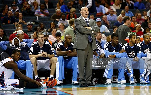 Head coach Steve Clifford of the Charlotte Bobcats stands at the bench with his team during their game against the Atlanta Hawks at Time Warner Cable...