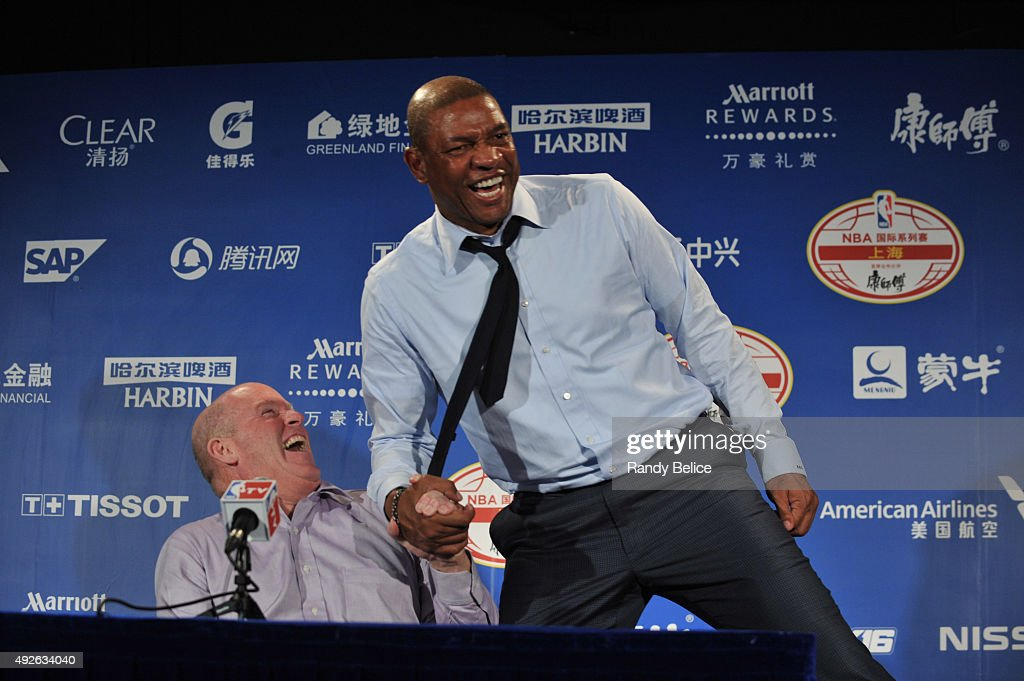 Head Coach Steve Clifford of the Charlotte Hornets chats after the game with Head Coach Doc Rivers of the Los Angeles Clippers as part of the 2015 NBA Global Games China at the Mercedes-Benz Arena on October 14, 2015 in Shanghai, China.