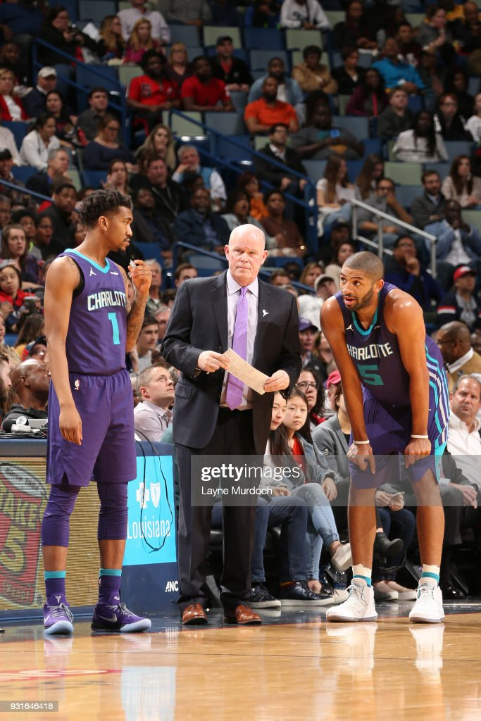 Head Coach Steve Clifford of the Charlotte Hornets speaks with Nicolas Batum #5 of the Charlotte Hornets and Malik Monk #1 of the Charlotte Hornets during the game against the New Orleans Pelicans on March 13, 2018 at Smoothie King Center in New Orleans, Louisiana.