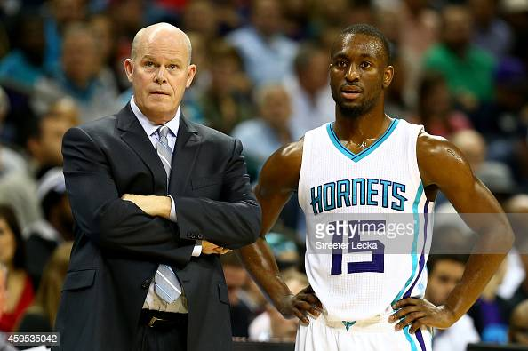 Head coach Steve Clifford of the Charlotte Hornets talks to Kemba Walker during their game at Time Warner Cable Arena on November 24 2014 in...