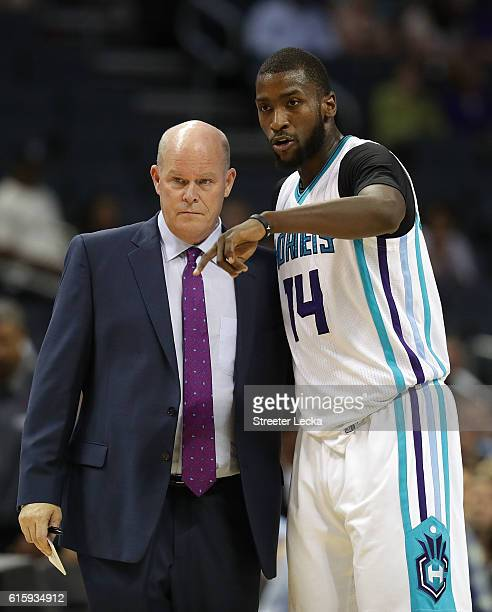 Head coach Steve Clifford of the Charlotte Hornets talks to Michael KiddGilchrist during their game against the Miami Heat at Spectrum Center on...