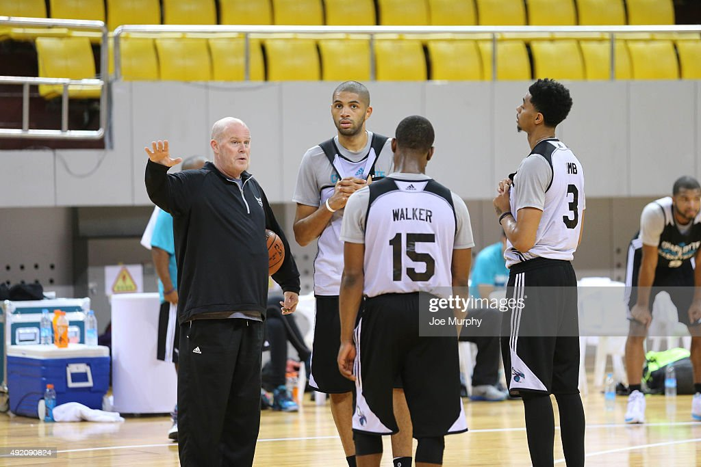 Head Coach Steve Clifford speaks to Nicolas Batum of the Charlotte Hornets during practice as part of the 2015 Global Games China at the Shenzhen City Arena on October 10, 2015 in Shenzhen, China.