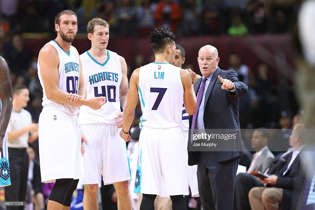 Head Coach Steve Clifford talks to Jeremy Lin of the Charlotte Hornets against the Los Angeles Clippers as part of the 2015 NBA Global Games China at...