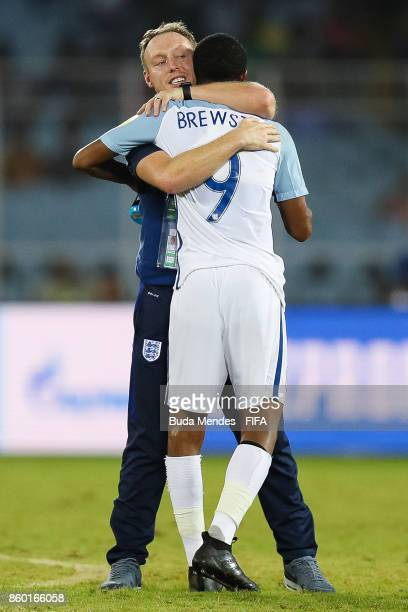 Head coach Steve Cooper greets Rhian Brewster of England after the FIFA U17 World Cup India 2017 group F match between England and Mexico at...