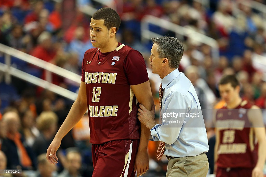 Head coach Steve Donahue of the Boston College Eagles talks with Ryan Anderson #12 on the sidelines against the Miami Hurricanes during the quarterfinals of the ACC Men's Basketball Tournament at the Greensboro Coliseum on March 15, 2013 in Greensboro, North Carolina.
