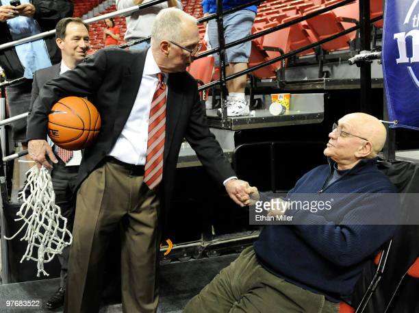 Head coach Steve Fisher of the San Diego State Aztecs greets former UNLV head coach Jerry Tarkanian after the Aztecs defeated the UNLV Rebels 5545 in...