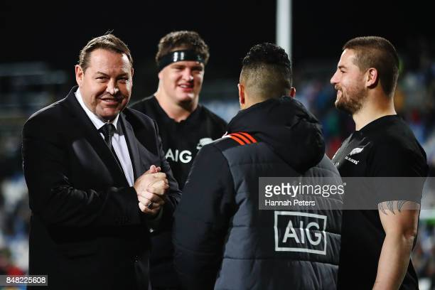 Head coach Steve Hansen of the All Blacks congratulates his players after winning the Rugby Championship match between the New Zealand All Blacks and...