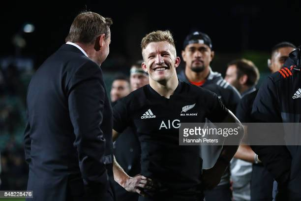 Head coach Steve Hansen of the All Blacks talks to Damian McKenzie after winning the Rugby Championship match between the New Zealand All Blacks and...