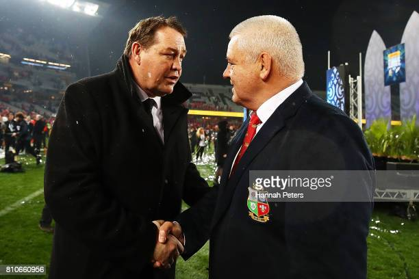 Head coach Steve Hansen shakes hands with head coach Warren Gatland of the Lions the Test match between the New Zealand All Blacks and the British...