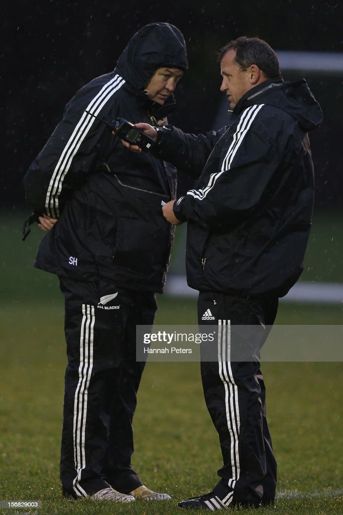 Head coach Steve Hansen talks with assistant coach Ian Foster during a training session at the University of Glamorgan training fields on November 22, 2012 in Cardiff, Wales.