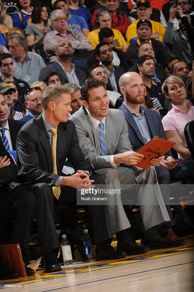 Head coach <a gi-track='captionPersonalityLinkClicked' href=/galleries/search?phrase=Steve+Kerr&family=editorial&specificpeople=238967 ng-click='$event.stopPropagation()'>Steve Kerr</a> chats with assistant coach <a gi-track='captionPersonalityLinkClicked' href=/galleries/search?phrase=Luke+Walton&family=editorial&specificpeople=202565 ng-click='$event.stopPropagation()'>Luke Walton</a> as their team faces the Oklahoma City Thunder on February 6, 2016 at Oracle Arena in Oakland, California.