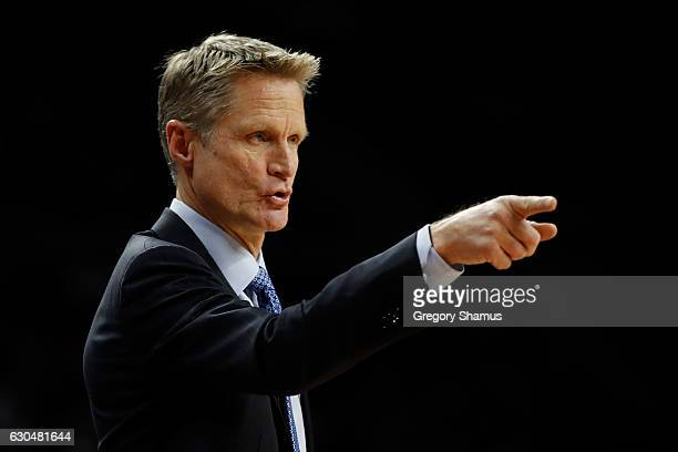 Head coach Steve Kerr looks on from the bench while playing the Detroit Pistonsat the Palace of Auburn Hills on December 23 2016 in Auburn Hills...
