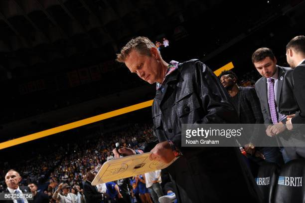 Head Coach Steve Kerr of the Golden State Warriors draws up a play during the game against the Washington Wizards on October 27 2017 at ORACLE Arena...